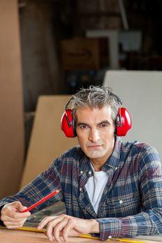 Serious carpenter with headphones