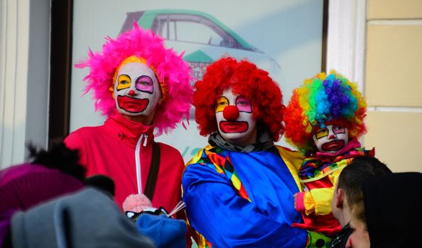 three colorful clowns at a carnival removals