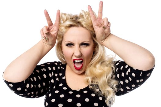 Angry woman with characteristic hand gesture