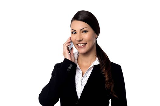 Businesswoman talking on cell phone over white