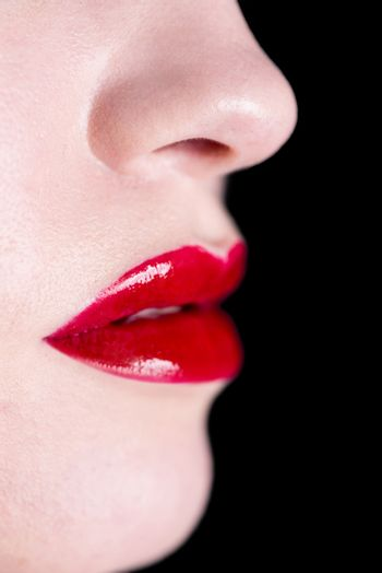 Attractive shiny red lips, sensual open mouth