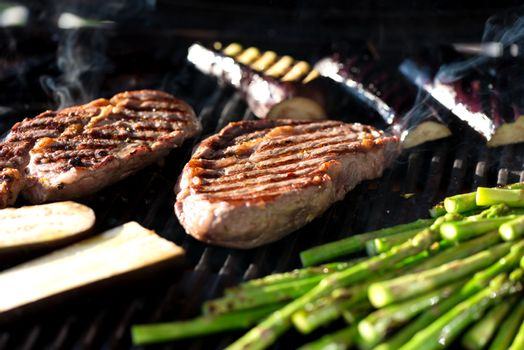 Steak and vegetables on grill
