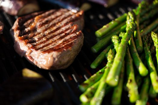 Steak and vegetables on grill macro