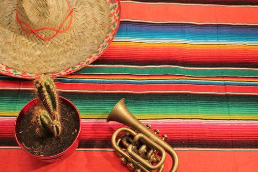 striped poncho serape fiesta background with copyspace