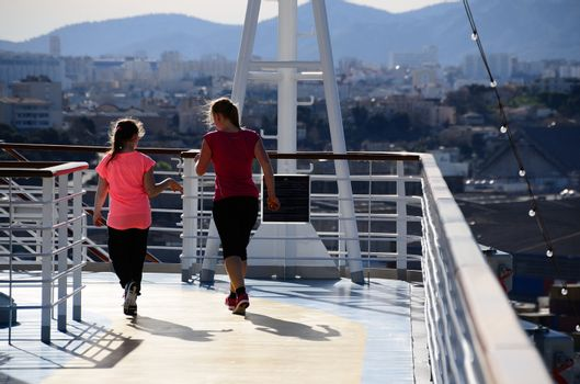 mother and daughter jogging on a cruise ship