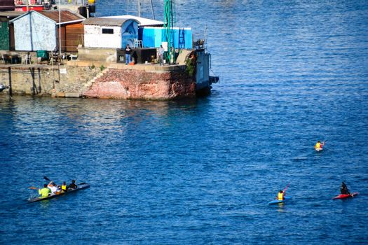 many canoeists train at the port in savona