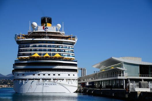 large cruise ship at dock in the port of Savona