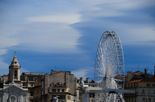 ferris wheel and houses in the harbor of Marseille