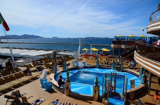 nice swimming pool on a huge cruise ship