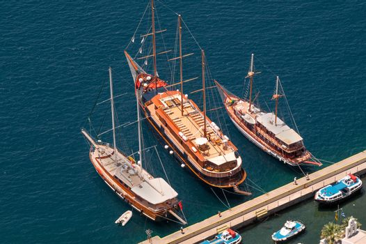 Three vintage wooden ships on Santorini island, Greece