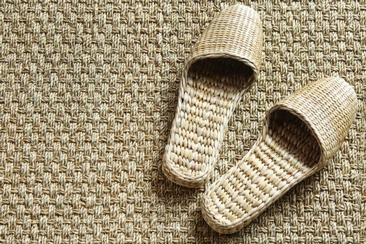 Seagrass spa slippers on woven carpet