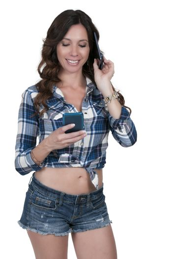 Beautiful woman talking and multitasking while juggling multiple cell phones and conversations