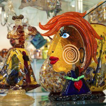 Murano glass artworks on display in shop in island of Murano, Venice.