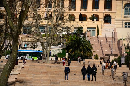 many stairs and palm trees in the city of Marseille