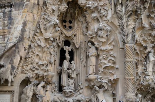 beautiful figures on old cathedral in the city of Barcelona