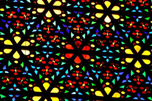 bright colorful window in church view details