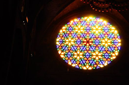 beautiful colorful windows in a large cathedral in Barcelona