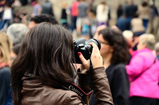 young photographer with leather jacket in the city of Barcelona
