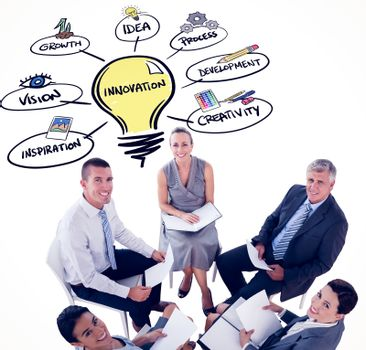 Composite image of business team sitting in circle and discussing
