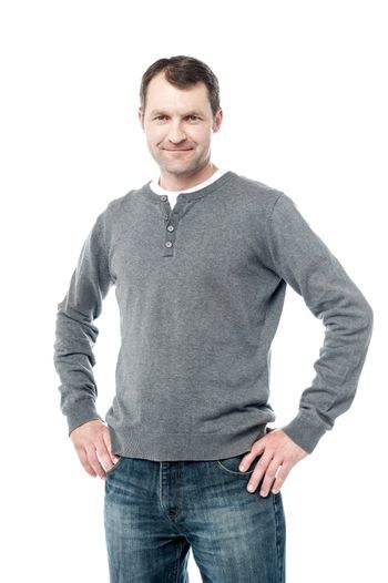 Handsome male posing in casuals, hand on hips.