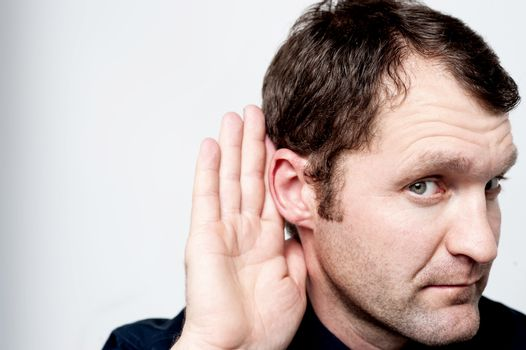 Close up of man secretly listening on conversation