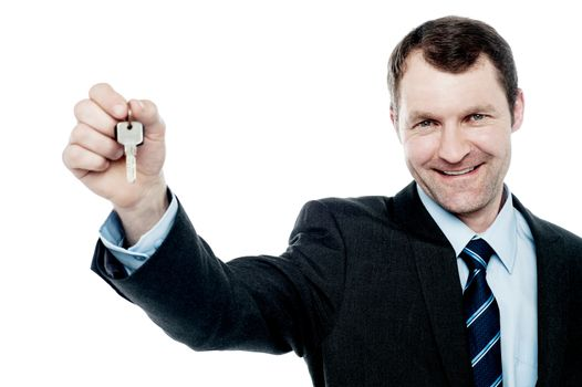 Happy businessman showing his new home key