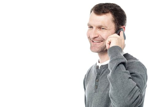 Sideways of casual man talking on cell phone