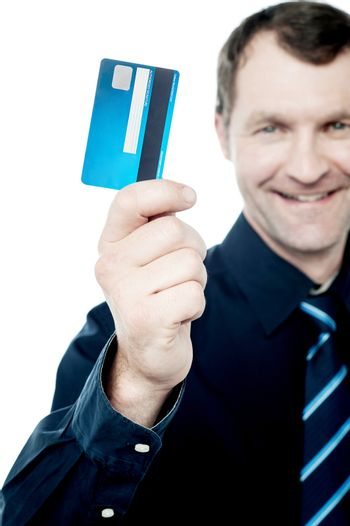 Cropped image of male executive showing credit card