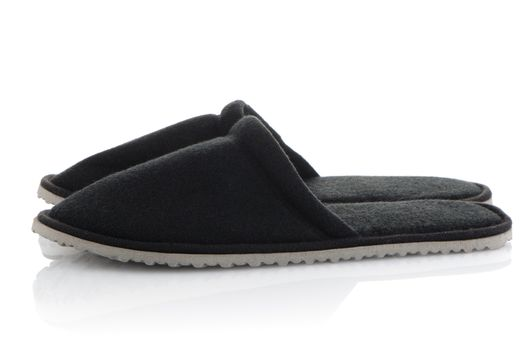 A pair of grey slippers
