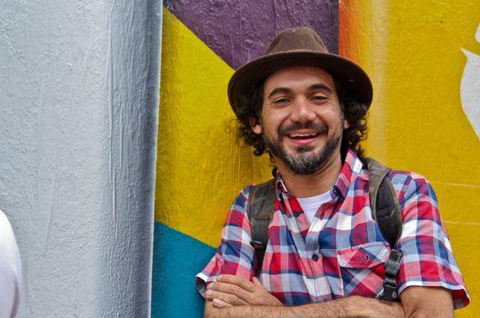 Sao Paulo, Brazil July 18, 2015: Graffiti artist Eduardo Kobra posing in front of his mural about recycling in Sao Paulo Brazil.