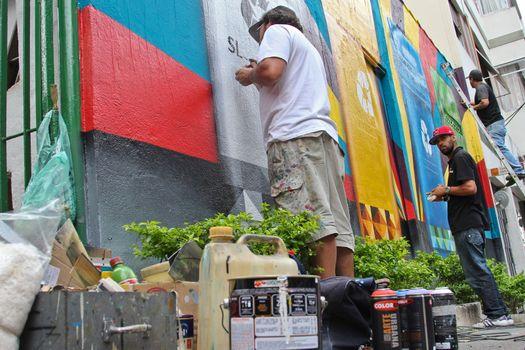 Sao Paulo, Brazil July 18, 2015: Graffiti in development from artist Eduardo Kobra staff in a mural about recycling in Sao Paulo Brazil.