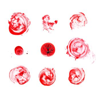 Various blood splatter isolated on white background, top view.