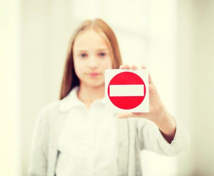 girl showing no entry sign