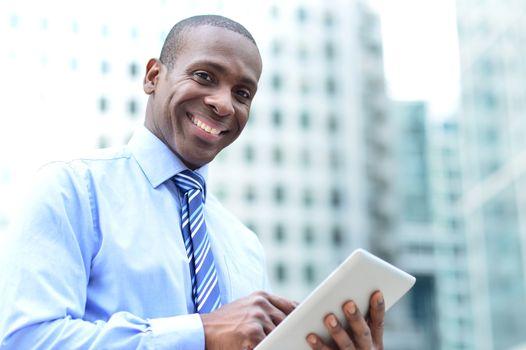 Businessman posing with digital tablet