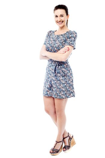 Full length of stylish woman in floral dress