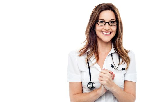 Happy female doctor with her hands clasped