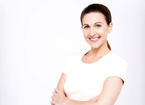 Pretty middle aged woman posing with folded arms
