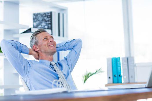 Businessman relaxing in swivel chair