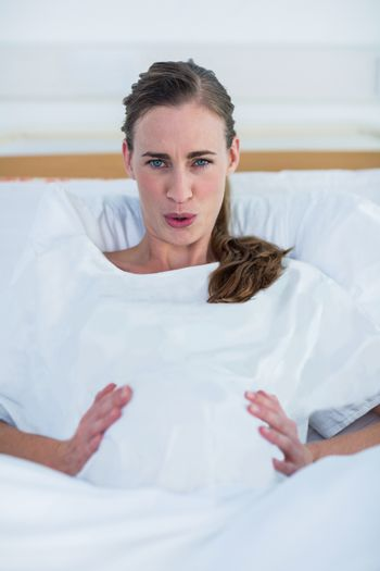 Portrait of pregnant woman suffering from pain