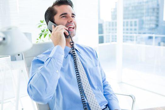 Smiling businessman phoning