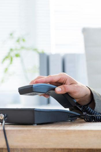 Businessman answer the phone