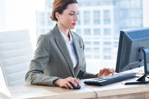Businesswoman using his computer