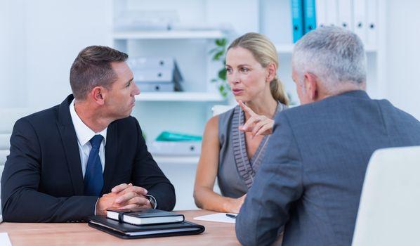 Business people speaking at meeting
