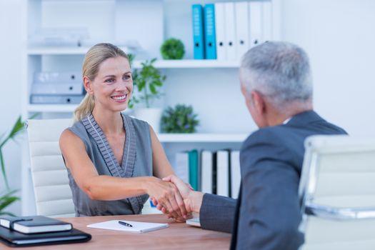 Businessman holding hand of businesswoman