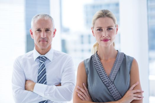Two business people looking at the camera