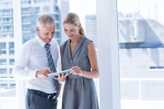 Business people discussing over a digital tablet