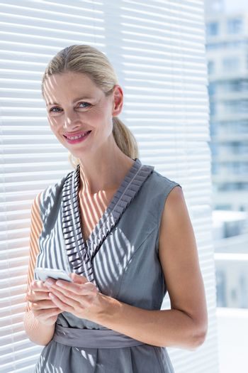 Smiling businesswoman looking at the camera