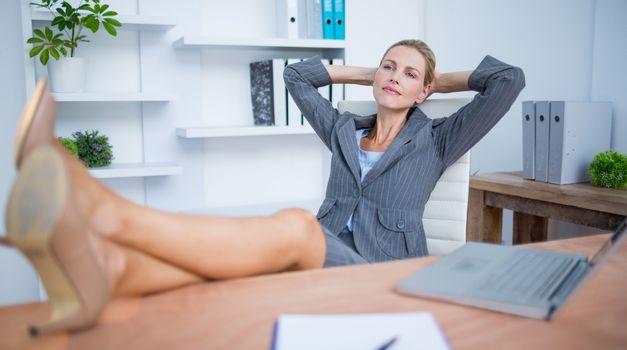 Pretty blonde businesswoman relaxing herself