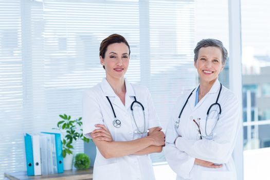 Portrait of smiling medical colleagues with arms crossed