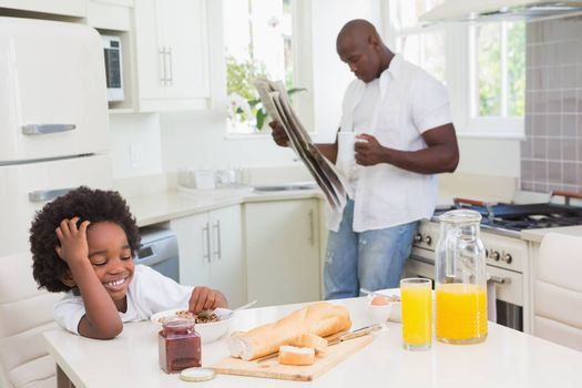 Smiling father and son taking a breakfast